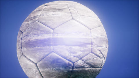 4K Super slow motion flying soccer ball on blue sky background ビデオ