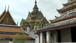 Thailand Bangkok 028 wat pho temple, zoom out from magnificent gables and roofs Footage