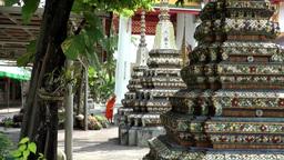 Thailand Bangkok 038 pillars with mosaics in yard of wat pho temple Footage
