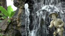 Thailand Bangkok 046 garden of wat pho temple, a figure and a fountain Footage
