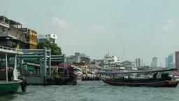 Thailand Bangkok 083 restaurants and boats at the shore of Chao Phraya River Footage