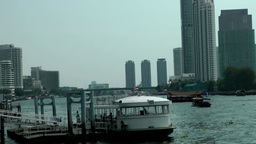 Thailand Bangkok 111 Chao Phraya River, piers, houseboats, modern architecture Footage