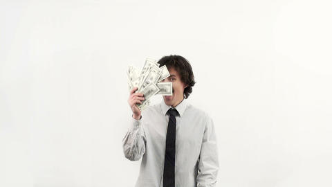 Businessman throws up a pack of dollars on white background Footage