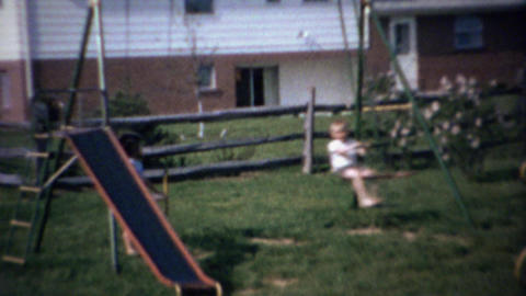 1963: Boy swings dangerously high on see saw type playground Footage