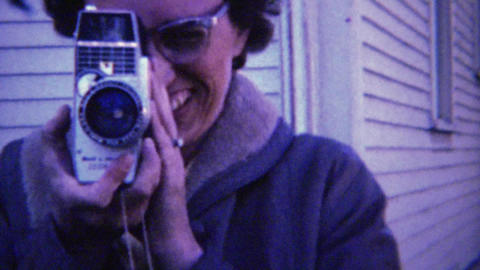 1961: 60's Style Eyeglasses Women Filming 8mm Movie Camera stock footage