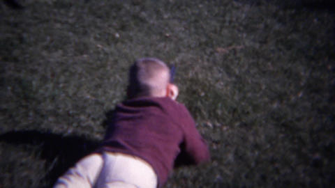 1961: Boy aims shotgun at targets in standing and prone position Footage