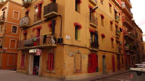 Orange residential house at Barri de la Barceloneta, panning shot Footage