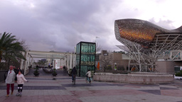 Waterfront promenade after rain, Port Olimpic area, Golden Fish sculpture Footage