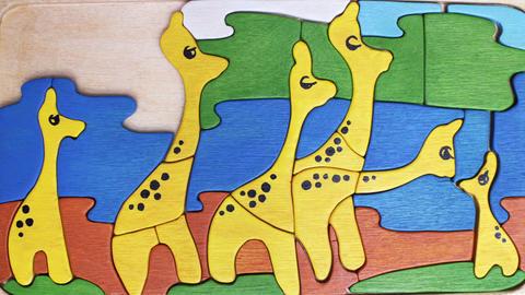 yellow giraffes puzzle cartoon Footage