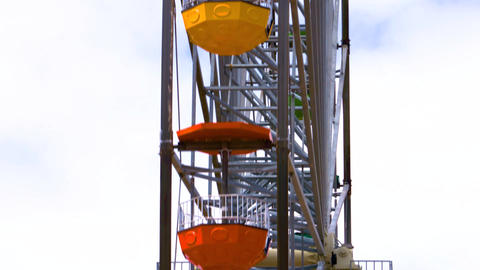 Close of multi coloured ferris wheel going round Live Action