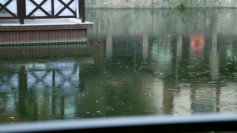 rain drops on water surface near the house Footage