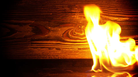Fire Burning and Wooden Background Bild