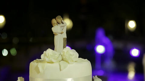 Great beautiful wedding cake, highlighted in different colors Filmmaterial