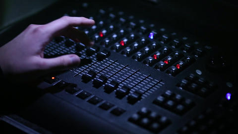 The sound engineer's hands close-up during the concert control the equipment Footage