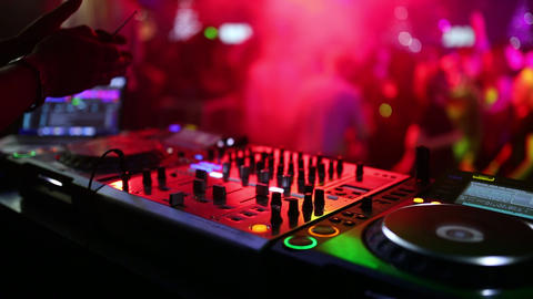 Professional close-up on a sound panel at a party in a nightclub. Light music Live Action