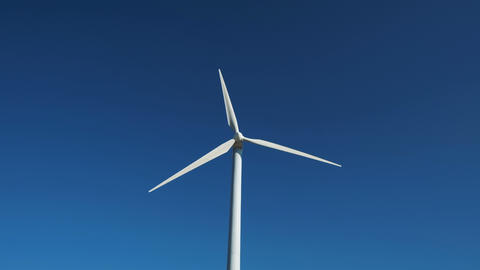 Green energy windmill turbine rotating at farm Footage