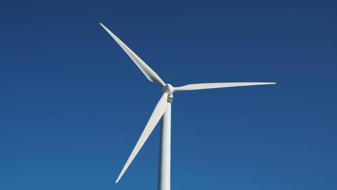 Green energy windmill turbine rotating at farm 영상물