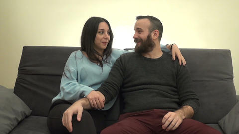 Couple Talking and Laughing on the Couch 2 Image