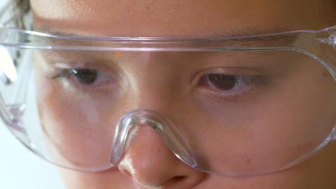 Young girl looking through safety glasses 2 1 Footage
