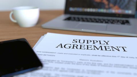 Copy of supply agreement on the desk ビデオ