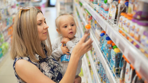 Mom with Baby Look for Child's Products Image