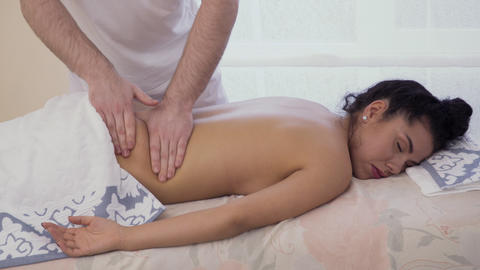 Young brunette relax during the massage session Footage