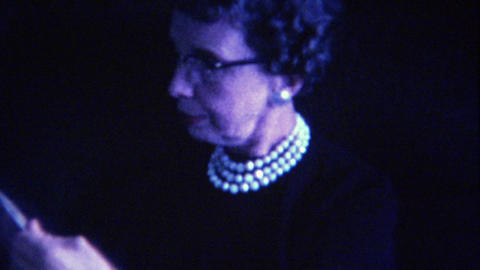 1963: Classy older women pearl necklace reading McCall's magazine Footage