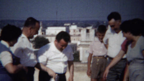 1954: Loud fun Italian family rooftop party sunny daytime… Stock Video Footage