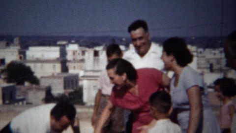1954: Loud fun Italian family rooftop party sunny daytime follies Live Action