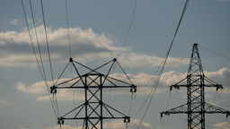 4K High-Voltage Power Lines in Clouds Footage