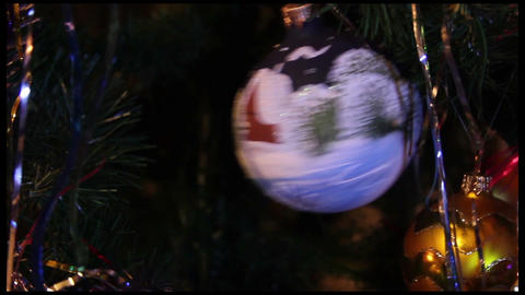 Christmas toy (blue ball) hanged on a Christmas (New Year) Tree Footage