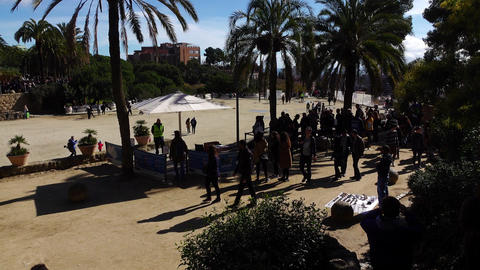 Park Guell passage at sunny day, people walk, empty Square of Nature terrace Footage