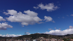 Light clouds, deep blue sky over Tibidabo mountain, sunny day view Footage