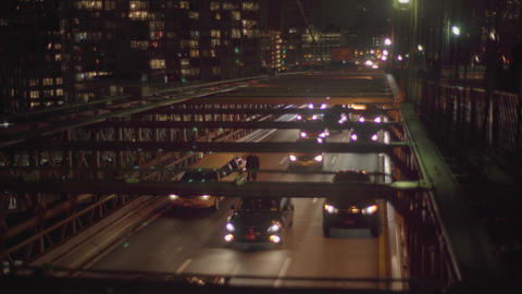 A lot of cars on the Brooklyn bridge by night NYC Footage