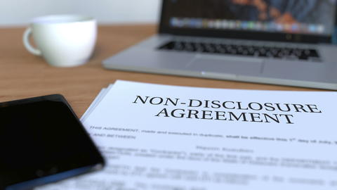 Copy of non-disclosure agreement on the desk. 3D rendering Foto