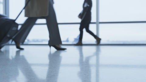 Walking people feet and shoes in airport Footage
