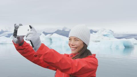 Girl taking selfie photo by Jokulsarlon Iceland Footage