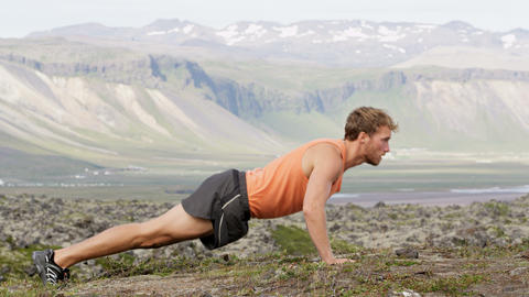 Fitness sport man doing push-ups outside nature Footage