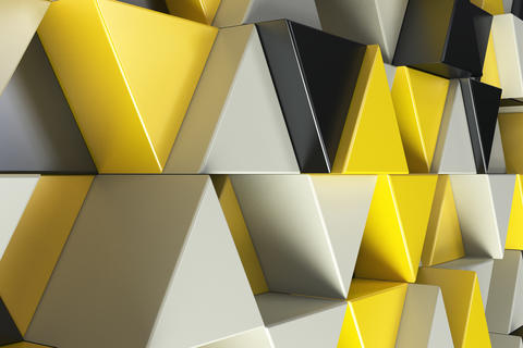 Pattern of black, white and yellow triangle prisms Foto