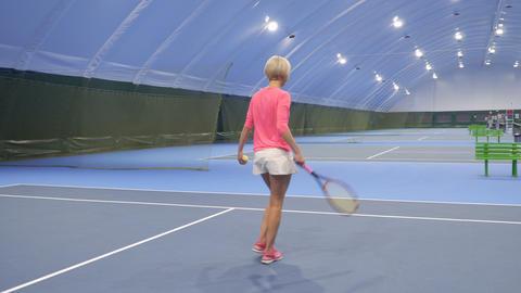 Pretty blonde play tennis Footage