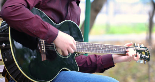 Young man playing acoustic guitar artist musician outdoors 영상물