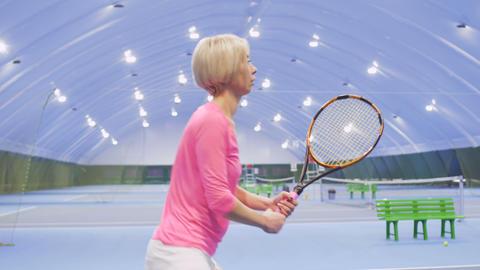 Professional tennis player hits tennis balls Footage