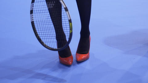 Woman in red shoes on high heels with tennis racquet Footage