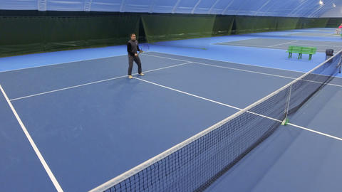 Young man play tennis at tennis court Footage