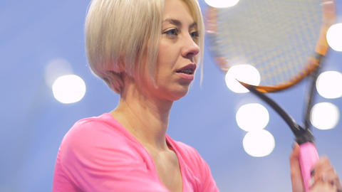 Beautiful caucasian blonde play tennis in slowmotion Footage