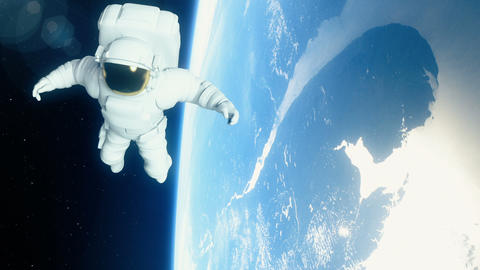 Astronaut in outer space is flying over the planet Earth Animation