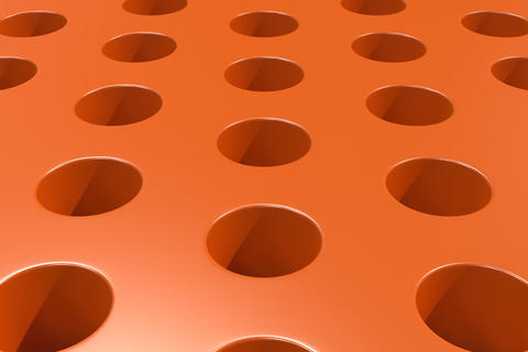 Plain orange surface with cylindrical holes Fotografía