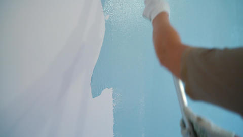 Painter paints the walls in blue color Footage