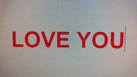 love you being typed on computer screen in close up Footage