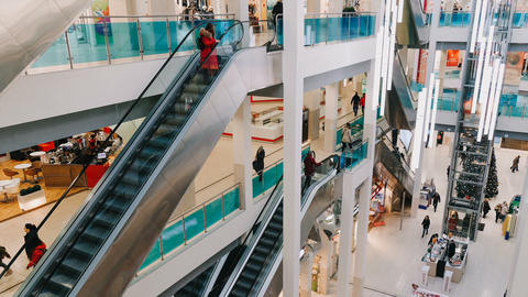 Time-lapse shopping center and escalator, hurrying people, 4k Footage